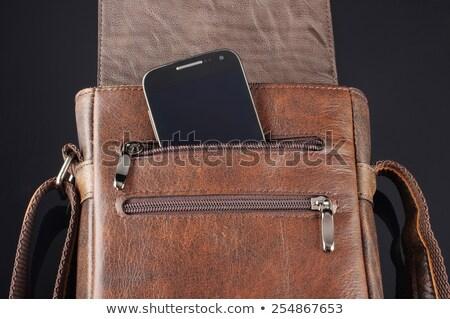 Smart phone inside pocket zip Stock photo © hin255