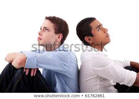two young man of different colors, sitting on floor, back to back Stock photo © alexandrenunes