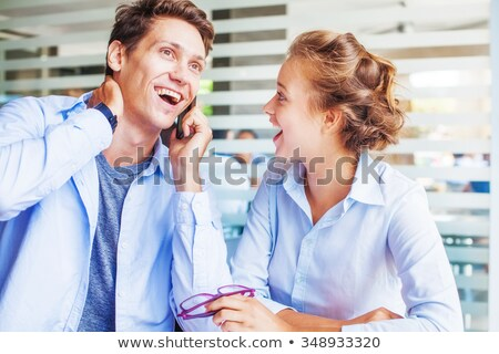 Portrait of a handsome young business man on cell phone getting good news Stock photo © deandrobot