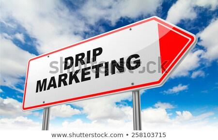 Drip Marketing on Red Road Sign. Stock photo © tashatuvango