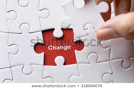 Change - White Word on Blue Puzzles. Stock photo © tashatuvango
