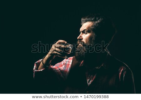 Retro businessman with martini. Stock photo © iofoto