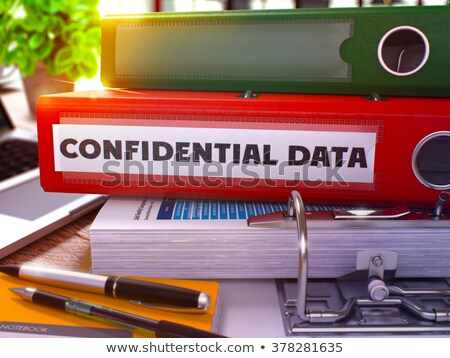 classified information on ring binder blured toned image stock photo © tashatuvango
