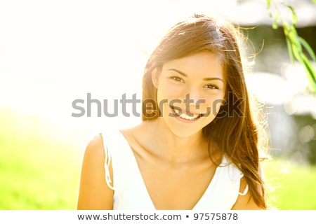 Stock photo: Young female model on grass