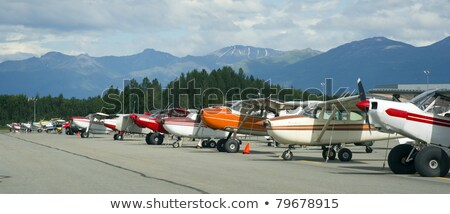 Bush Plane Prop Airplane Airport Anchorage Chugach Mountains Stock photo © cboswell