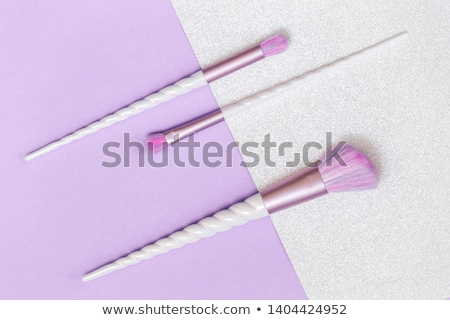 top view of makeup brush and three lipsticks stock photo © elisanth