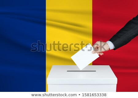 Man putting a ballot into a voting box - Romania Stock photo © Zerbor