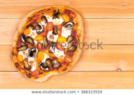 Hand tossed homemade vegetarian pizza Stock photo © ozgur