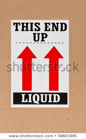 Liquid - This end up Stock photo © ShawnHempel