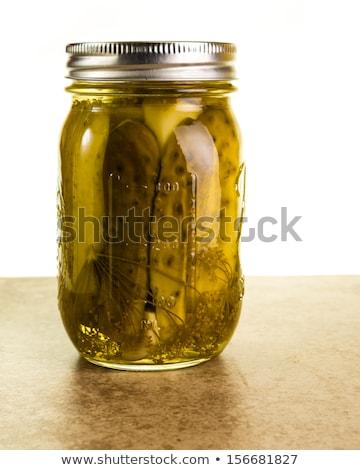 Ogórki konserwowe blacie kuchennym trzy papieru charakter Zdjęcia stock © filipw
