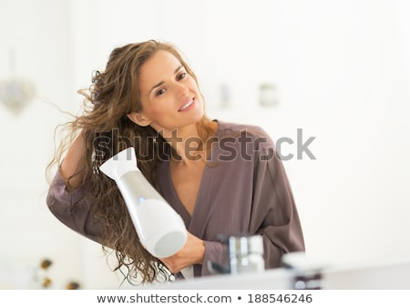 young female drying hair hairdryer stock photo © studiostoks