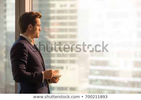 młodych · biznesmen · stałego · patrząc · biały - zdjęcia stock © filipw
