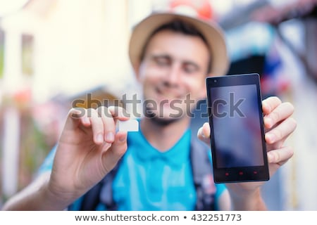Male hand holding mobile phone SIM card Stock photo © stevanovicigor