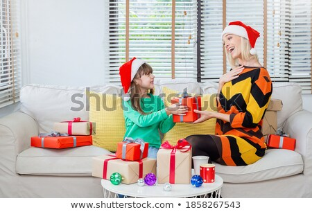 little girl wrapping xmas gifts in her living room stock photo © ozgur