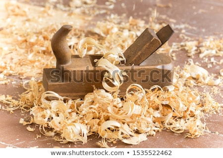 shaving with plane in a woodworker workshop Stock photo © Giulio_Fornasar