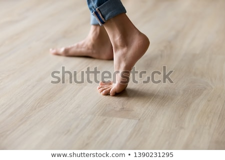 Female feet on wooden floor Stock photo © Nobilior