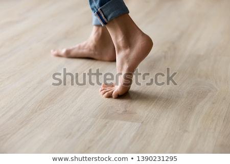 female feet on wooden floor stock photo © nobilior