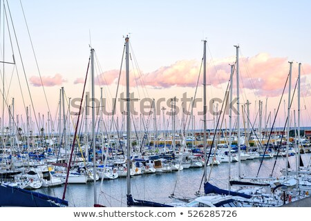 Boats at the Pier in Barcelona, Spain. Warm Sunset Stock photo © frimufilms