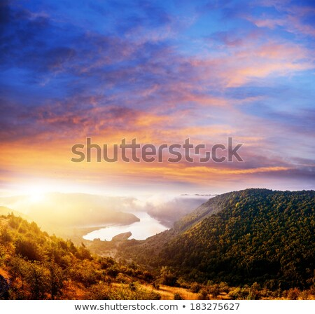 Steppe prairie landscape with rays of sunlight  Stock photo © TasiPas