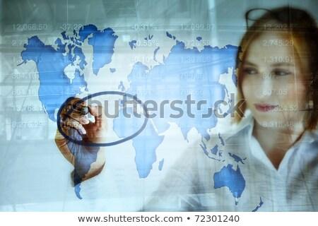 Businesswoman tracking stock market indicators Stock photo © stevanovicigor