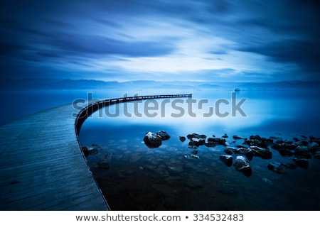 Vibrant skies and curved jetty Stock photo © lovleah