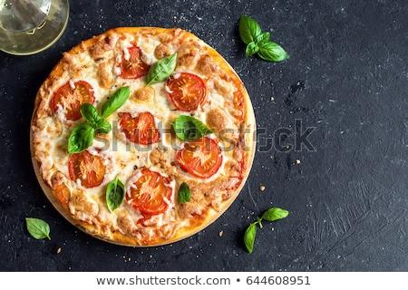 pizza · mozzarella · fetta · tavolo · in · legno · pomodoro - foto d'archivio © monkey_business