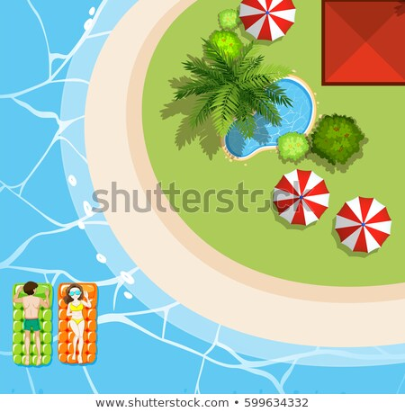 beach scene with two tourists on floats stock photo © bluering