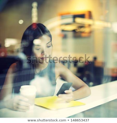 nő · okostelefon · laptop · munka · állomás · vásárlás - stock fotó © andreypopov