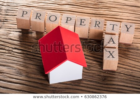 property tax blocks with a miniature house stock photo © andreypopov