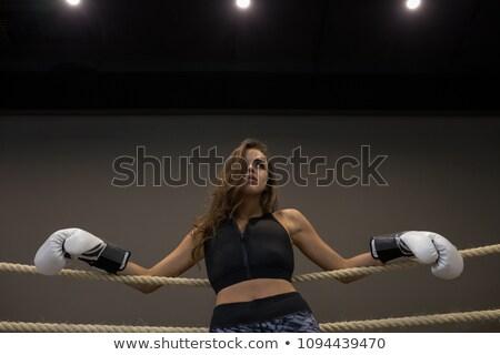 Sérieux jeunes fort sport dame boxeur Photo stock © deandrobot