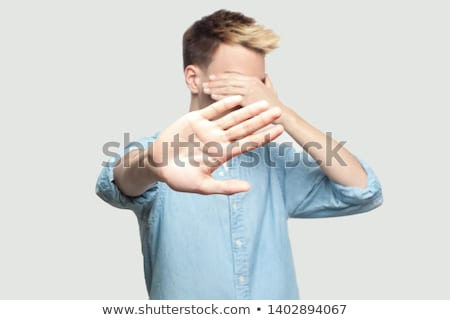 Young businessman covering face with his hands Stock photo © gsermek