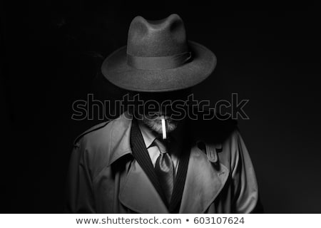 Noir film character smoking a cigarette Stock photo © stokkete