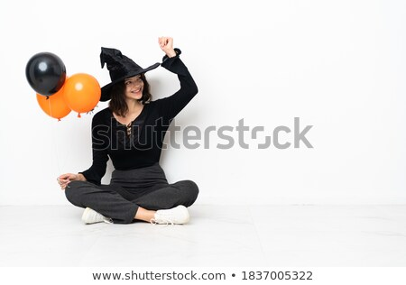 Full length image of screaming woman in halloween costume Stock photo © deandrobot