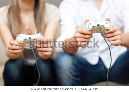 Woman Holding Video Game Controller Stock photo © monkey_business