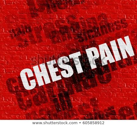 Gezondheid maagzuur Rood muur moderne gezondheidszorg Stockfoto © tashatuvango