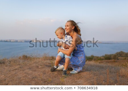 Stock photo: Mother holding child in river