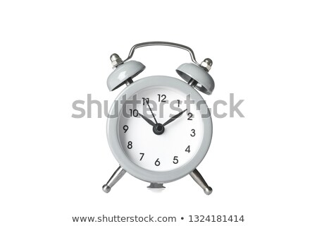 Closeup view of colorful alarm clock on light green background.  Stock photo © Nobilior