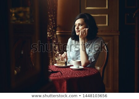 Young girl with cake, daydreaming Stock photo © IS2