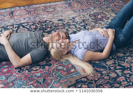 Girls napping on carpet together Stock photo © IS2