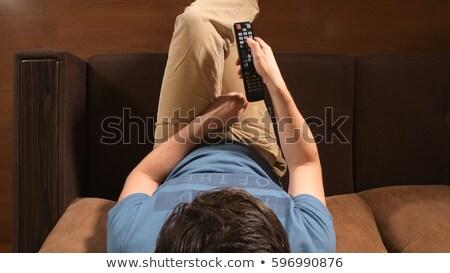 Férfi kéz távirányító okos szelektív fókusz televízió Stock fotó © stevanovicigor