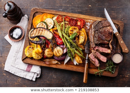 Zucchini and potatoes on a chopping board Stock photo © stokkete