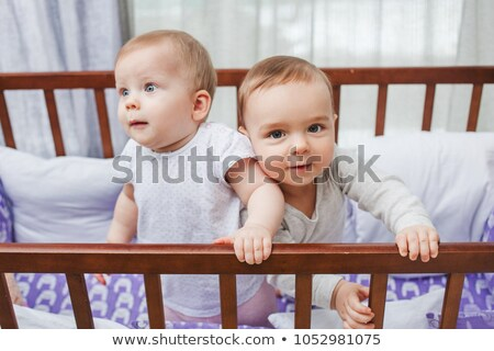 Two toddlers in cot Stock photo © IS2
