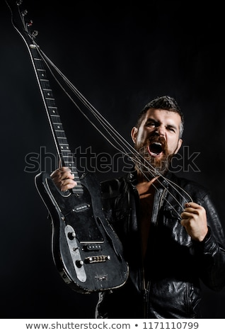 Bearded man playing bass guitar on stage Stock photo © sumners