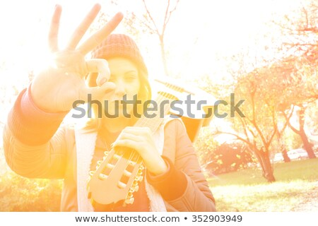 portrait of woman with colorful clothes and guitar on shoulder Stock photo © feedough