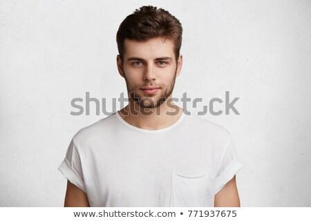 Jóképű fickó borosta fehér póló néz Stock fotó © deandrobot