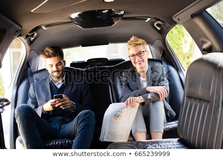 beautiful couple sitting in a limousine stock photo © konradbak