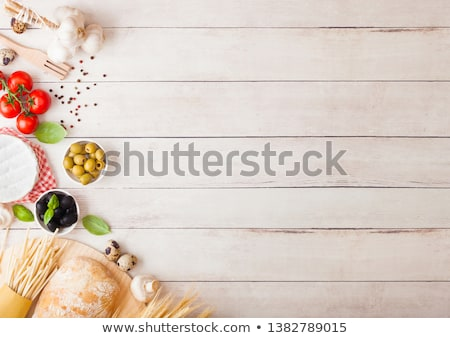 Homemade spaghetti pasta with quail eggs with bottle of tomato sauce and cheese on wooden background Stock photo © DenisMArt