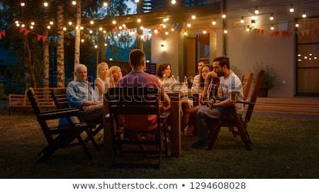 family gathering at summer garden and celebration Stock photo © dolgachov