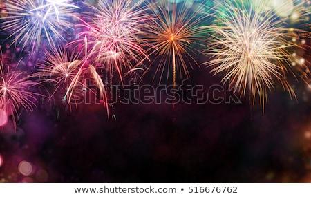 Foto stock: Firework On Night Background Anniversary Bursting Fireworks