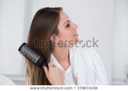 Close-up Of A Woman Combing Her Hair Stock photo © AndreyPopov